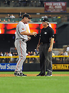 June 14 2011; Phoenix, AZ, USA; San Francisco Giants manager Bruce Bochy talks with the first base umpire about a call made during the sixth inning against the Arizona Diamondbacks at Chase Field. Mandatory Credit: Jennifer Stewart-US PRESSWIRE..