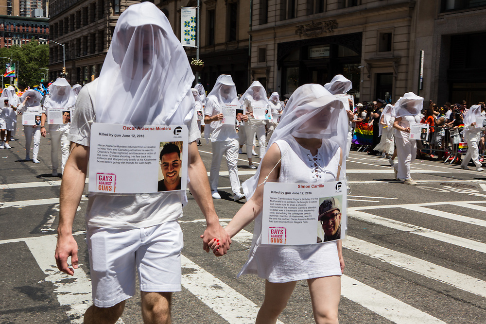 New York, NY - 25 June 2017. New York City Heritage of Pride March filled Fifth Avenue for hours with groups from the LGBT community and it's supporters.Marchers from Gays Against Guns dressed in white, with white veils over their heads, each bearing a card with the name, photograph, and history of a young gay or lesbian killed by guns. Commemorate by these marchers are Oscar Aracena-Montero and Simon Carrillo, killed in the Pulse nightclub.