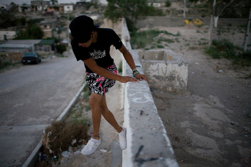 Jose Miguel, 14, jumps off a wall, in the Diaz Ordaz colonia in Ciudad Juarez, Chihuahua Mexico on April 28, 2010.