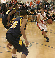 The Beavers Alex Marolo (10) faces Wildcat defenders Michael Cooper (left) and Demetrius Clay as the Beavercreek Beavers host the Springfield South High School Wildcats Friday night, February 2, 2007.