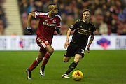 Middlesbrough FC midfielder Albert Adomah (27) in action shadowed by Nottingham Forest midfielder Robert Tesche (32) during the Sky Bet Championship match between Middlesbrough and Nottingham Forest at the Riverside Stadium, Middlesbrough, England on 23 January 2016. Photo by George Ledger.