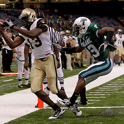 October 9, 2010; New Orleans, LA, USA; Army Black Knights wide receiver Davyd Brooks (13) catches a touchdown over Tulane Green Wave cornerback Phillip Davis (13) during the first half at the Louisiana Superdome.  Mandatory Credit: Derick E. Hingle