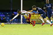 Bradford's forward Dominic Poleon is held back by Southend's defender Ryan Leonard during the EFL Sky Bet League 1 match between Southend United and Bradford City at Roots Hall, Southend, England on 16 December 2017. Photo by Matt Bristow.