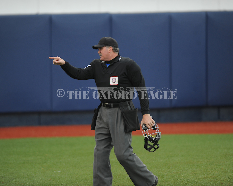 Home plate umpire Steve Dew points into the North Carolina-Wilmington at Oxford-University Stadium in Oxford, Miss. on Saturday, February 25, 2012. Ole Miss won 6-4.