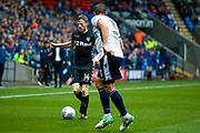 Leeds United midfielder Eunan O'Kane (14) holds the ball up during the EFL Sky Bet Championship match between Bolton Wanderers and Leeds United at the Macron Stadium, Bolton, England on 6 August 2017. Photo by Simon Davies.