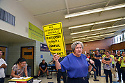 Volunteers from Keep Tucson Together and attorney Margo Cowan provide legal assistance to persons effected by changes to DACA, or Deferred Action Childhood Arrival, which provided legal protection to those brought into the United States illegally as children, at a clinic at Pueblo Magnet High School, Tucson, Arizona, USA. Attorney Margo Cowan addresses attendees.