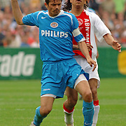 NLD/Rotterdam/20060507 - Finale competitie 2005/2006 Gatorade cup Ajax - PSV, Urby Emanuelson (19) in duel met Phillip Cocu