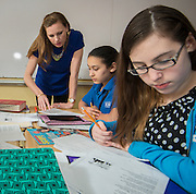 Angela Arterburn works with her 7th grade English students at Revere Middle School, April 17, 2014.