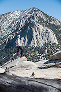 Caitlin Looby checks out the view of Tahquitz Peak from Suicide Rock in Idyllwild, California.
