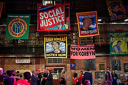 © Licensed to London News Pictures. 24/09/2016. Liverpool, UK. Socialist banners inside the venue before Labour MPs and supporters celebrate  the re-elected of Labour Party Leader Jeremy Corbyn at a party organised by Momentum in Liverpool.  Photo credit: Ben Cawthra/LNP