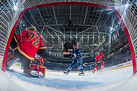 PENTICTON, CANADA - SEPTEMBER 11: Mason McDonald #72 of the Calgary Flames makes a save on a shot by Jordy Stallard #67 of Winnipeg Jets on September 11, 2017 at the South Okanagan Event Centre in Penticton, British Columbia, Canada.  (Photo by Marissa Baecker/Shoot the Breeze)  *** Local Caption ***