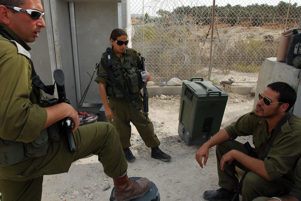 IDF woman and men reserve soldiers are holding a checkpoint in South of Moount Hebron area, South of Israel. Following their active service, women, like men, are in theory required to serve up to one month annually in reserve duty. However, in practice only some women, mostly in combat roles, get called for active reserve duty, and only for a few years following their active service, with many exit points (e.g., pregnancy).