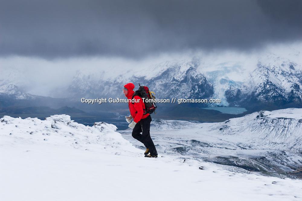 Arnar Felix Einarsson with the glacier Gígjökull in the background, Iceland.