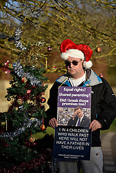 © Licensed to London News Pictures. 24/12/2014. Dean, Oxfordshire UK. Terry Vooght. Fathers for Justice protestors plan to spend Christmas protesting in the village of Dean where the Prime Minister David Cameron lives. The protestors are led by Bobby Smith, long time protestor who protested to David Cameron during his surf holiday at Polzeath in August 2014. Photo credit : MARK HEMSWORTH/LNP