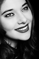 studio portrait on black background of an expressive woman
