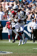 Los Angeles Rams defensive back Sam Shields (37) tries to break away from Arizona Cardinals wide receiver Chad Williams (10) as he leaps and intercepts a fourth quarter pass and runs it back 22 yards to the Arizona Cardinals 25 yard line during the 2018 NFL regular season week 2 football game against the Arizona Cardinals on Sunday, Sept. 16, 2018 in Los Angeles. The Rams won the game in a 34-0 shutout. (©Paul Anthony Spinelli)
