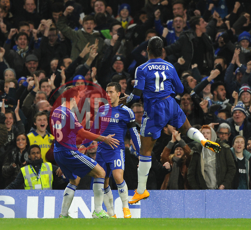 Chelsea's Eden Hazard celebrates his goal with Chelsea's Cesar Azpilicueta and Chelsea's Didier Drogba. - Photo mandatory by-line: Dougie Allward/JMP - Mobile: 07966 386802 - 03/12/2014 - SPORT - Football - London - Stamford Bridge - Chelsea v Tottenham Hotspur - Barclays Premier League
