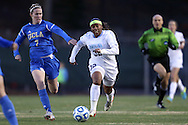 30 November 2013: North Carolina's Meg Morris (32) is chased by UCLA's Jenna Richmond (7). The University of North Carolina Tar Heels played the University of California Los Angeles Bruins at Fetzer Field in Chapel Hill, North Carolina in a 2013 NCAA Division I Women's Soccer Tournament Quarterfinal match. UCLA won the game 1-0 in two overtimes.