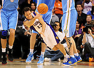 Dec. 22, 2011; Phoenix, AZ, USA; Phoenix Suns point guard Steve Nash (13) makes a one handed pass while playing against the Denver Nuggets during the first half of a preseason game at the US Airways Center. Mandatory Credit: Jennifer Stewart-US PRESSWIRE.