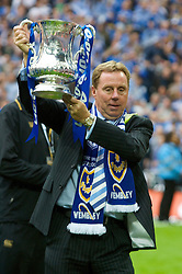LONDON, ENGLAND - Saturday, May 17, 2008: Portsmouth's manager Harry Redknapp celebrates with the trophy after his side beat Cardiff City 1-0 during the FA Cup Final at Wembley Stadium. (Photo by David Rawcliffe/Propaganda)
