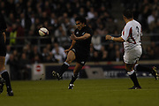 Twickenham. GREAT BRITAIN,  Mils MULIAINA, kicking clear, during  the 2006 Investec Challenge, game between, England  and New Zealand [All Blacks], on Sun., 05/11/2006, played at the Twickenham Stadium, England. Photo, Peter Spurrier/Intersport-images].....   [Mandatory Credit, Peter Spurier/ Intersport Images].