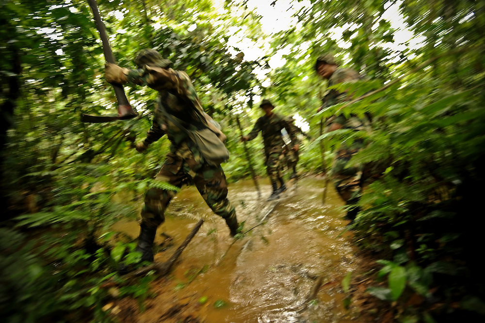 Counternarcotics forces walk deep into the tropical lowlands during a patrol to eradicate coca patches that are over the legal limit in Chapare. It's estimated that 90 percent of coca from the Chapare goes to the drug trade.