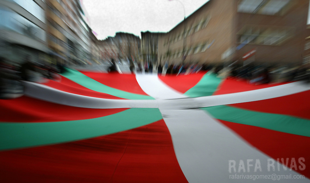 "A big ""ikurrina"" (Basque flag) is carried during a demonstration, 03 April 2004, in the northern Spanish Basque city of Bilbao, organized by the outlawed pro independence Basque party Batasuna. PHOTO RAFA RIVAS"