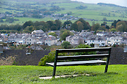 A wooden bench overlooking houses in Skipton, North Yorkshire, UK.