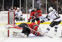 Oct 13; Newark, NJ, USA; Los Angeles Kings left wing Simon Gagne (12) scores a goal past New Jersey Devils goalie Martin Brodeur (30) during the first period at the Prudential Center.