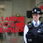Campaigners against a Heathrow airport expansion spray paint the windows of the Labour party HQ to make Labour vote no to a proposed expansion of the airport at a future parliamnetary vote. All the paint is easily removes and leaves no stain.