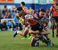 Mitch Allgood (floor) of Wakefield Trinity Wildcats tackles Jesse Sene-Lefao of Castleford Tigers during the Pre-season Friendly match at Belle Vue, Wakefield<br /> Picture by Richard Land/Focus Images Ltd +44 7713 507003<br /> 15/01/2017