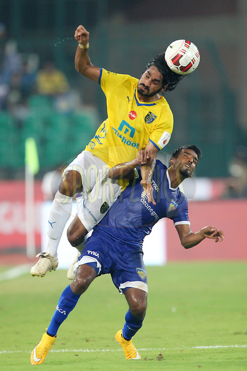 Sandesh Jhingan of Kerala Blasters FC and Abhishek Das of Chennaiyin FC challenge for the high ball during match 9 of the Hero Indian Super League between Chennaiyin FC and Kerala Blasters FC held at the Jawaharlal Nehru Stadium, Chennai, India on the 21st October 2014.<br /> <br /> Photo by:  Ron Gaunt/ ISL/ SPORTZPICS