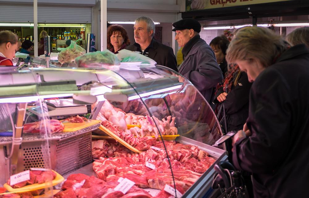 RIGA, LATVIA - CIRCA MAY 2014: People buying in Riga Central Market