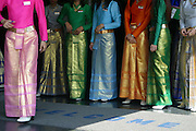 A group of Welcoming ladies at a Gold and Gem factory outlet in Bangkok, Thailand.