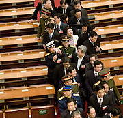Delegates line up to leave after a session of the National People's Congress after a session in the Great Hall of the People. Chinese leaders are trying to improve energy efficiency to reduce both environmental damage and China's reliance on imported oil, which they see as a strategic weakness.