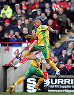 London - Saturday, January 12th, 2008: Andy Johnson of Barnsley and Dion Dublin of Norwich City during the Coca Cola Champrionship match at Oakwell, Barnsley. (Pic by Paul Hollands/Focus Images)