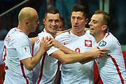 Warsaw, Poland - 2017 October 08: Robert Lewandowski of Poland celebrates with team mates after scoring during soccer match Poland v Montenegro - FIFA 2018 World Cup Qualifier at PGE National Stadium on October 08, 2017 in Warsaw, Poland.<br /> <br /> Mandatory credit:<br /> Photo by &copy; Adam Nurkiewicz / Mediasport<br /> <br /> Adam Nurkiewicz declares that he has no rights to the image of people at the photographs of his authorship.<br /> <br /> Picture also available in RAW (NEF) or TIFF format on special request.<br /> <br /> Any editorial, commercial or promotional use requires written permission from the author of image.