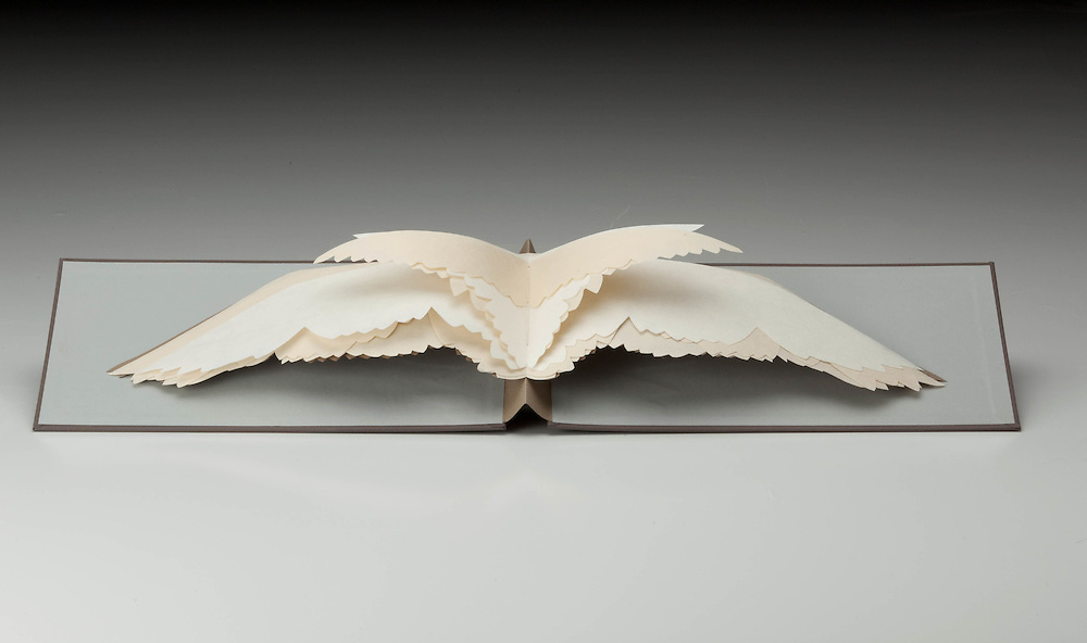 Briony Morrow-Cribbs. Pamphlet stitch book opens to a bird in flight.