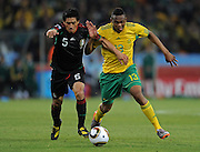 FIFA SOCCER WORLD CUP 2010, SOCCER CITY in SOWETO, 11 June 2010. Midfielder of Bafana, Kagisho DIKGACOI and Defender of Mexico, Ricardo OSORIO compete for the ball during the Opening match, Match#1 between South Africa and Mexico at SOCCER CITY Stadium in Soweto, Johannesburg, South Africa on 11 June 2010.<br /> Photographer : Anton de Villiers / SPORTZPICS