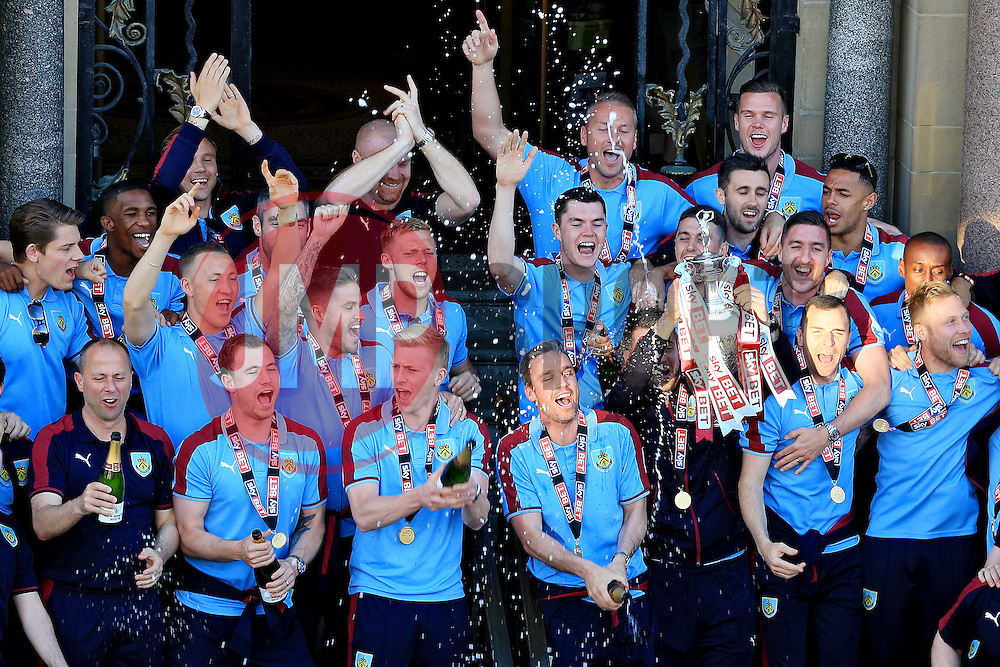 The Burnley FC players and staff celebrate by lifting the SkyBet Championship Trophy outside Burnley Town Hall - Mandatory by-line: Matt McNulty/JMP - 09/05/2016 - FOOTBALL - Burnley Town Hall - Burnley, England - Burnley FC Championship Trophy Presentation