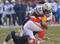 Dec 28, 2014; Kansas City, MO, USA; Kansas City Chiefs tight end Travis Kelce (87) is tackled by San Diego Chargers inside linebacker Kavell Conner (53) during the second half at Arrowhead Stadium. The Chiefs won 19-7. Mandatory Credit: Denny Medley-USA TODAY Sports
