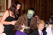 "Elena Monigold (left) watches Jerry Francis apply Halloween makeup to an audience member during Mayhem & Mystery's production of ""Costume Carousing"" at the Spaghetti Warehouse in downtown Dayton, Monday, September 12, 2011."