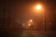 Night time foggy, near empty street