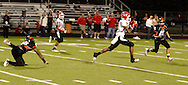 Senior Armani Miller (7) with the ball and headed to the end zone at the end of the second quarter as the Wayne Warriors play the Beavercreek High School Beavers at the Frank Zink Field in Beavercreek, Friday, October 7, 2011.