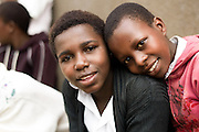 Children in the Nyamagabe District of Rwanda's Southern Province The Nyamagabe Area Development Program (ADP) located here is one of many long-term development initiatives led by the international nonprofit World Vision. Area Development Programs work within communities like Nyamagabe over a period of several years, providing developmental resources to foster long-term, sustainable growth in the economic and physical well being of the community.
