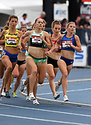 Jul 25, 2019; Des Moines, IA, USA; Jenny Simpson and Shannon Osika lead a women's 1,500m heat during the USATF Championships at Drake Stadium.