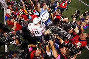 INDIANAPOLIS, IN - SEPTEMBER 19: Peyton Manning #18 of the Indianapolis Colts meets with his brother Eli Manning #10 of the New York Giants following their game at Lucas Oil Stadium on September 19, 2010 in Indianapolis, Indiana. The Colts won 38-14. (Photo by Joe Robbins) *** Local Caption *** Peyton Manning;Eli Manning