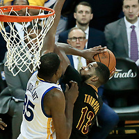 12 June 2017: Cleveland Cavaliers center Tristan Thompson (13) goes for the layup against Golden State Warriors forward Kevin Durant (35) during the Golden State Warriors 129-120 victory over the Cleveland Cavaliers, in game 5 of the 2017 NBA Finals, at the Oracle Arena, Oakland, California, USA.