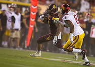 Arizona State University and University of Southern California in a football game on September 26, 2015 in Tempe, AZ.  USC won 42 to 14.  At half, USC led 35 to 0.<br /> <br /> A pair of eights, D.J. Foster (8) ASUcarries the ball in the third quarter is followed by Iman Marshall (8) USC.