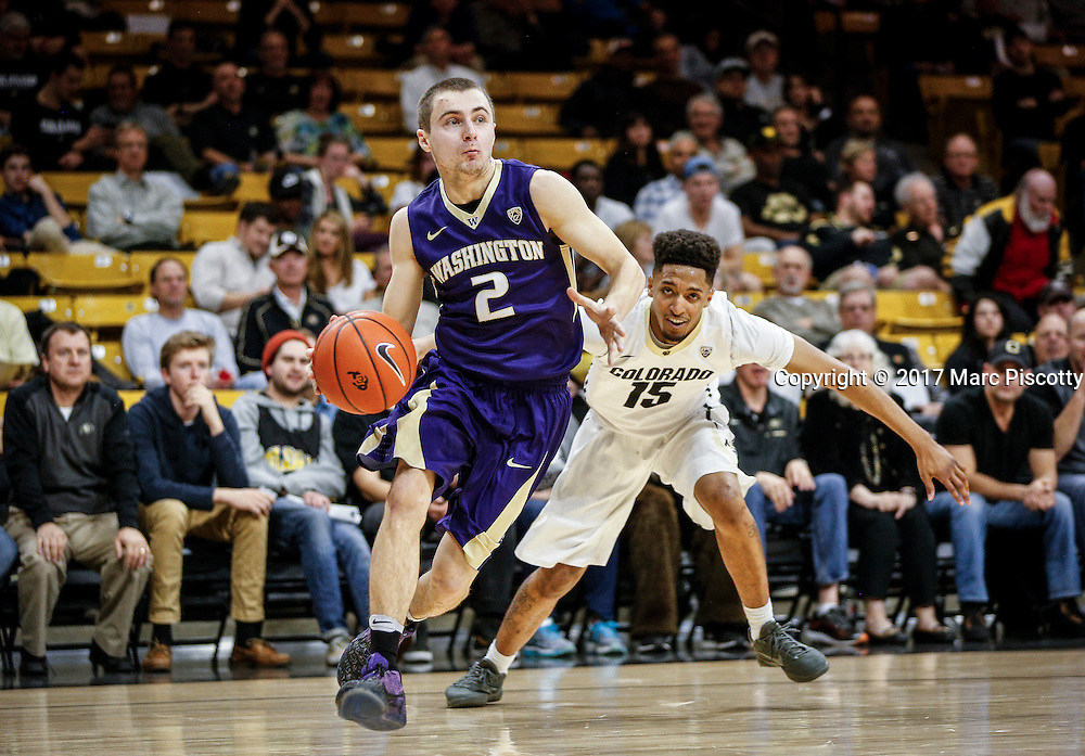 SHOT 2/9/17 10:26:48 PM - Washington's Dan Kingma #2 drives past Colorado's Dominique Collier #15 during their regular season Pac-12 college basketball game at the Coors Events Center in Boulder, Co. Colorado won the game 81-66. (Photo by Marc Piscotty / © 2017)